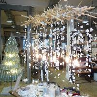 Free-standing recycled glass bottle Christmas tree and broken crockery chandelier by Replica