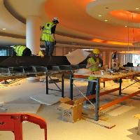 Replica installing one of the giant chandeliers at Westfield White City, London