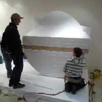 Preparations to install a giant polystyrene snowball at Nicole Farhi, New Bond Street London