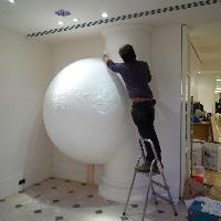 Installing a giant polystyrene snowball at Nicole Farhi, New Bond Street London
