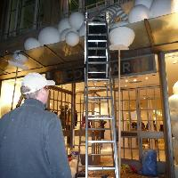 Installing a giant polystyrene snowball display at Nicole Farhi, New Bond Street London